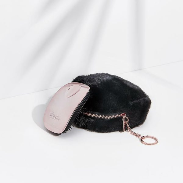 Fluffy, bold, and stuffed with a pocket brush to keep your hair coiffed anytime, anywhere – our Pom Pocket Keychain is a must-have accessory for your purse, bag, or fanny packHow-to-use:1. Clip pouch to bag2. For hair emergencies, use the pocket brush by detangling on-the-go